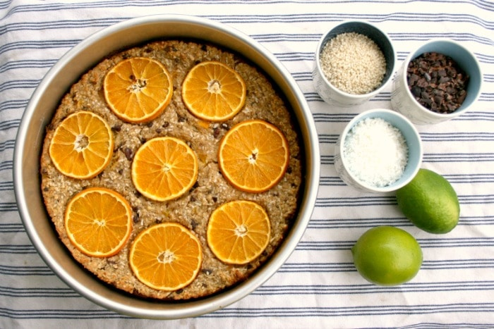 Baked oatmeal recipe with oranges sesame seeds and cacao nibs