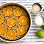 Baked oatmeal with oranges, sesame seeds, cacao nibs and ginger
